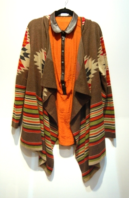 Tahsa Polizzi brown cardigan and orange shirt